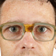 Face in bad old spectacles — Stock Photo