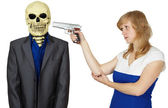Woman threatens with pistol to person - skeleton — Stock Photo