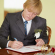 Stock Photo: Groom solemnly signed documents