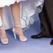 Feet of groom and bride - wedding composition — Stock Photo