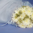 Wedding bouquet and veil — Stock Photo