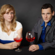 Man and woman drinking red wine at table — Foto Stock