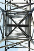 High-voltage steel tower - bottom view — Stock Photo