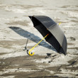 Large old-fashioned black umbrella - Stock Photo