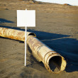 Stock Photo: Sign near old rotting pipe - ecological disaster