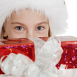 Teen girl in Christmas hat with a gift — Stock Photo #4219136