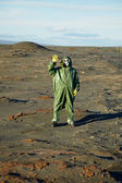 Strange scientist in overalls and gas masks — Stock Photo
