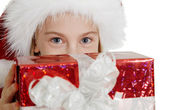 Teen girl in Christmas hat with a gift — Stock Photo