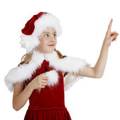 Surprised smiling girl in Christmas clothes points a finger — Stock Photo