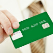 Green electronic plastic card in hand - Stock Photo