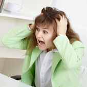 Frightened business woman loudly shouts — Stock Photo