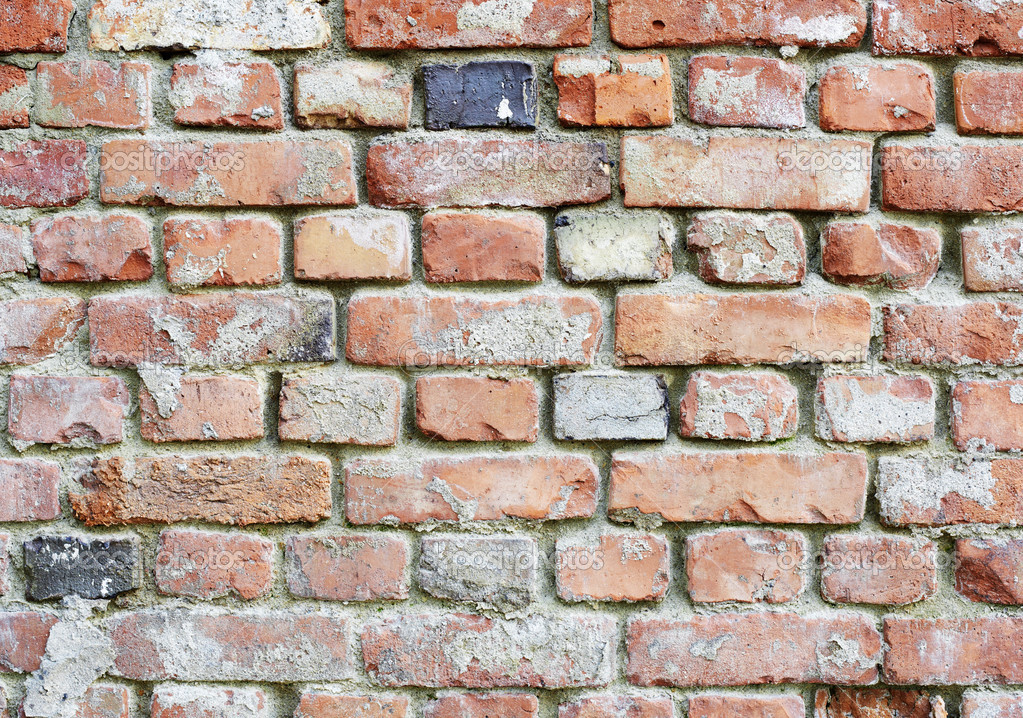 Old dilapidated rough brick red wall with stains — Stock Photo #4268690