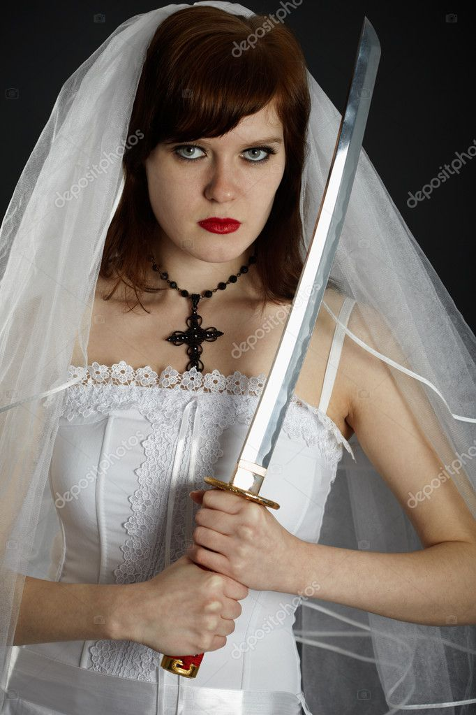 Young Bride armed eastern sword on dark background — Stock Photo #4268803