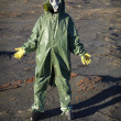Man in chemical protective suit in desert - Stock Photo