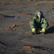 Stock Photo: Min protective clothing sitting in desert