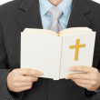 Man reads Catholic Bible — Stock Photo