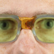 Person in old bad spectacles with poor eyesight — Stock Photo #4310639
