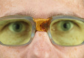 Person in old bad spectacles with poor eyesight — Stock Photo