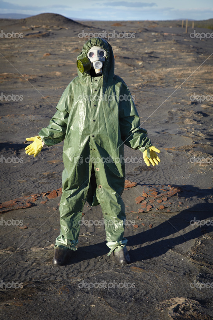 A man in a chemical protective suit stands in the desert — Stock Photo #4310269