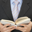 Stock Photo: Businessmreading statute book