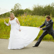 Bride and groom having fun — Stock Photo