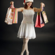 Woman rejoices to Christmas purchases — Stock Photo