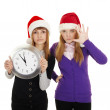 Stock Photo: Friends show how little time is left until new year