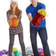 Stock Photo: Man and woman give gifts isolated on white