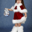 Little girl in Christmas costume with glass ball — Stock Photo