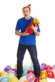 Cheerful man with New Year's gift in hands — Stock Photo
