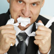 Irate manager tears teeth documents — Stock Photo