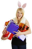 Girl with rabbit ears rejoice many gifts — Stock Photo