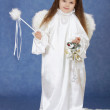 Little girl in suit of angel on a blue background — Stock Photo