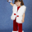 Little girl in New Year costume holding glass ball — Stock Photo