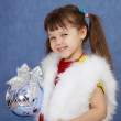 Little girl in white fur costume holding glass ball — Stock Photo