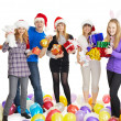 Stock Photo: Happy friends with New Year's gifts on white background