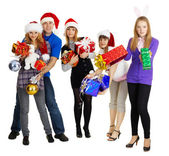 Group of young with New Year's gifts — Stock Photo