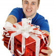 Stock Photo: Funny man happily gives us a gift