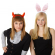 Royalty-Free Stock Photo: Two friends in festive costume devil and bunny