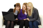 Schoolgirls watching adult sites — Stock Photo