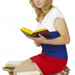 Stock Photo: Wom- student reads books on white background