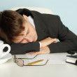 Office worker was tired and fell asleep at table — Stock Photo