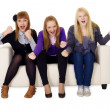 Jubilant young womon sofa — Stock Photo #4721880