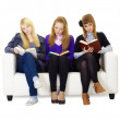 Three girls teen carefully read the books — Stock Photo #4899365