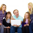 Large family with a laptop — Stock Photo