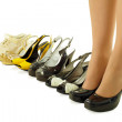 Stock Photo: Female legs in high heels