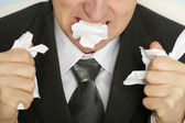 Businessman furiously tearing paper — Stock Photo