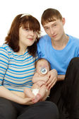 Young family - dad, mom and baby — Stock Photo