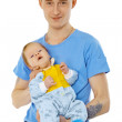 Young man is holding his son - infant — Stock Photo