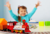 Happy child playing with railway — Stock Photo